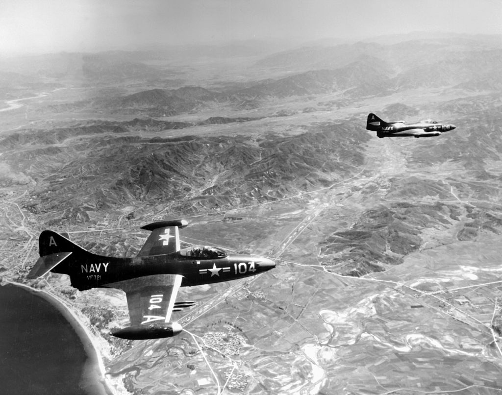 Two F9F-2Bs of VF-721 over Korea..jpg