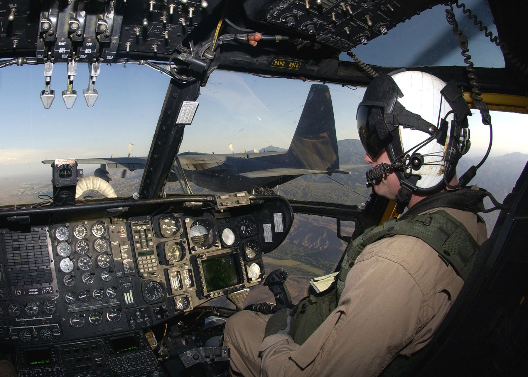 View of the CH-53E's cockpit during an in-flight refueling operation with an Air Force HC-130 Hercul
