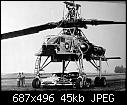 Two cars parked beneath the XH-17 give a sense of scale.jpg